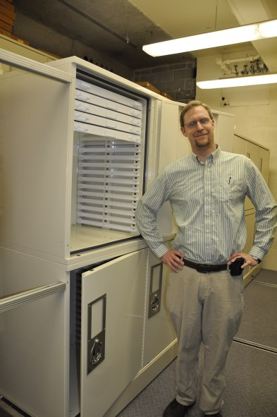 Dr. Davis with newly installed specimen cabinets in the fossil vault