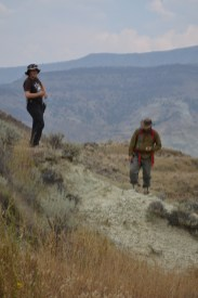 Danielle and Nick exploring the outcrops of Bull Canyon on a smokey day