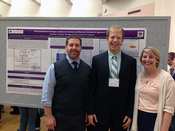Dr. Doug Dixon, Dr. Mikhail Garibov, Dr. Tracy Popowics stand in front of their research poster