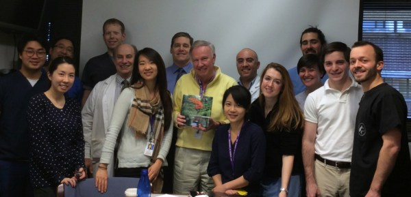 The residents presented Dr. Smith with a photo book of Washington State, signed with their appreciation.