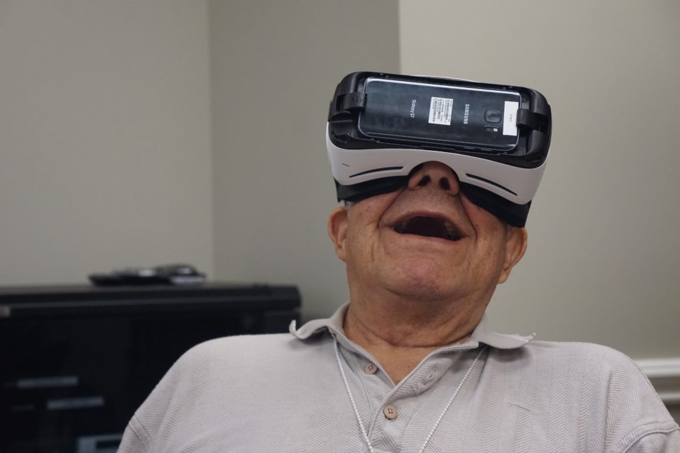 A senior resident at Maplewood Senior Living experiences virtual reality with a Rendever VR headset. (Maplewood Senior Living)