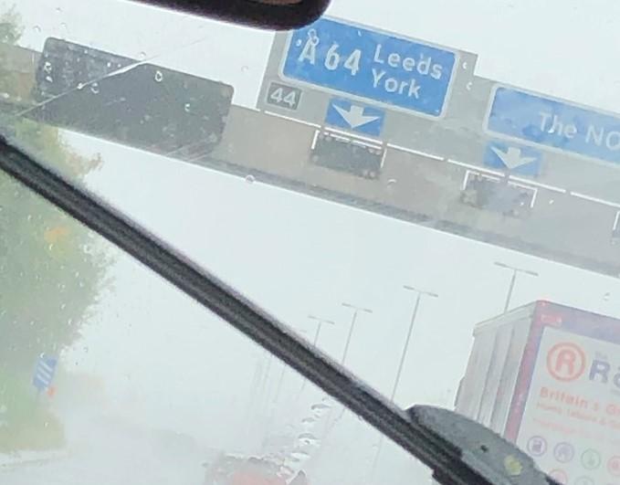 Motorway signs in the rain
