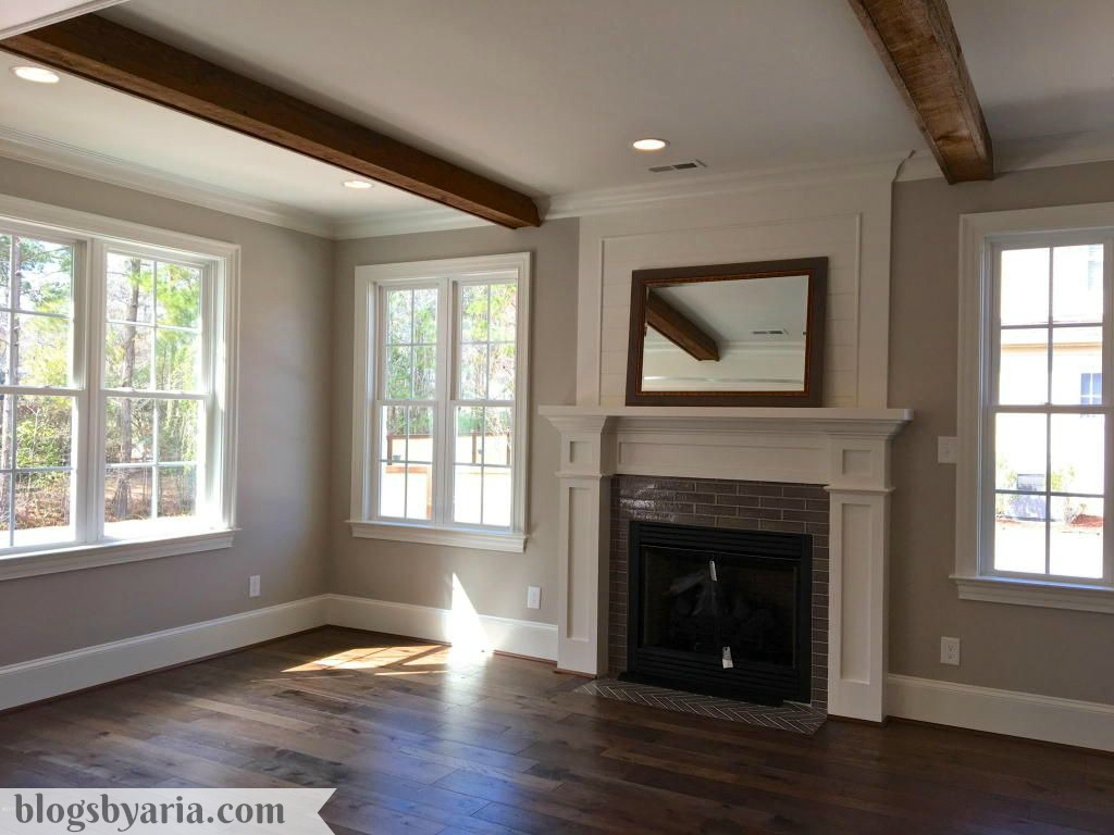 morning room with wooden beams and gorgeous tile fireplace