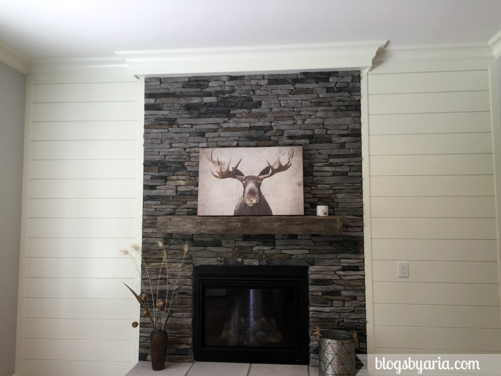 shiplap wall and stone fireplace in keeping room --Elks House