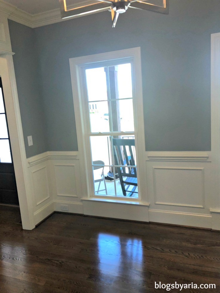 dining room wainscoting with long windows