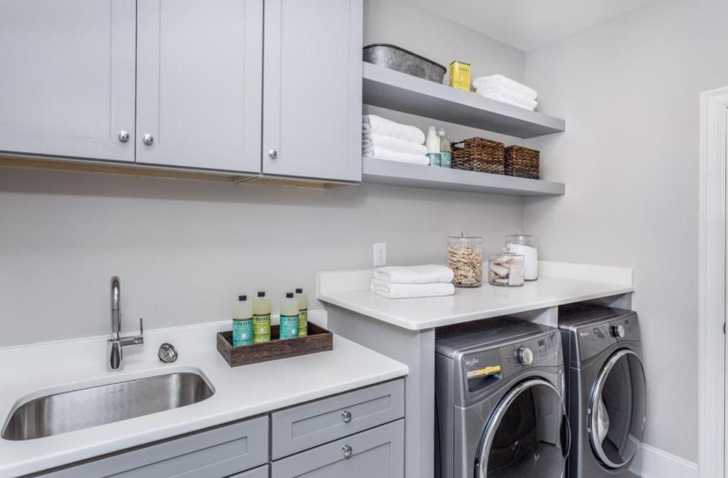 gray laundry room open shelving