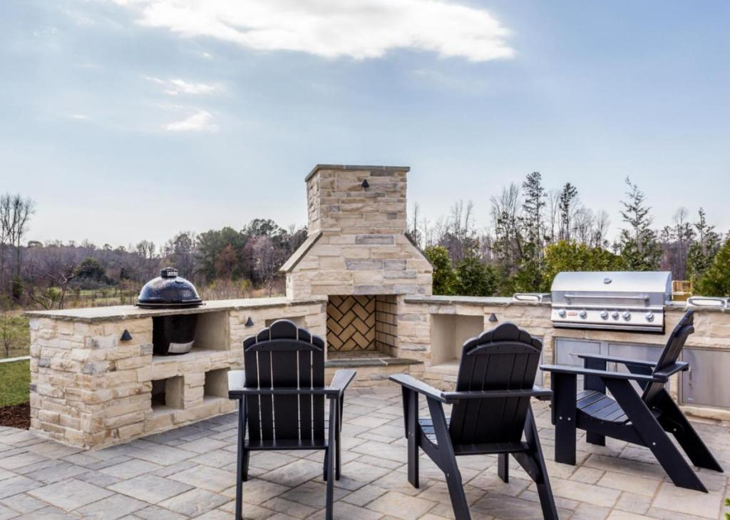 outdoor kitchen including fireplace, gas grill and smoker built in