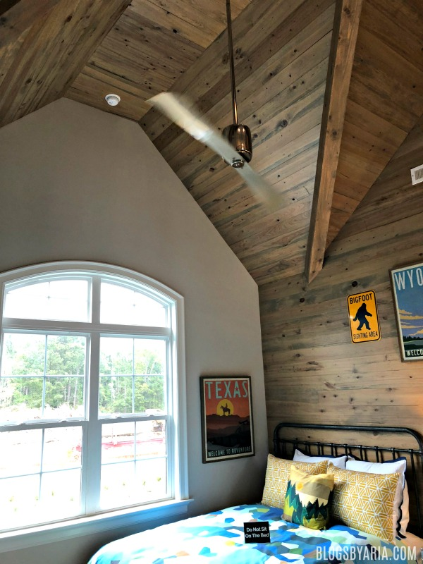 wood planked feature wall and ceiling