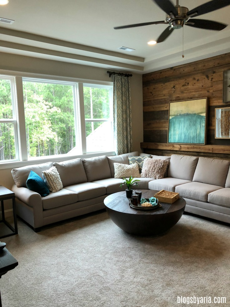 living space featuring reclaimed wood plank wall