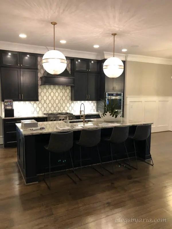 dark kitchen cabinetry in this large kitchen