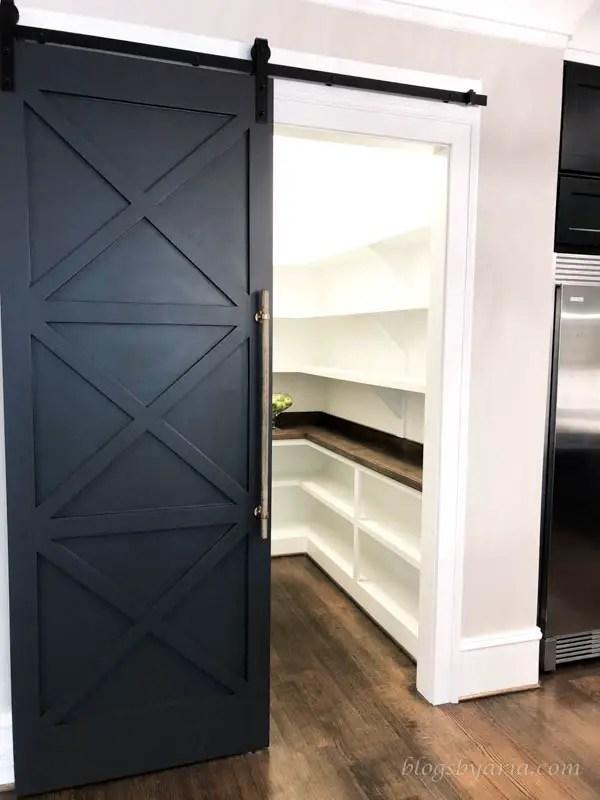 barnwood doors lead to the walk in pantry