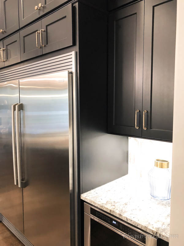 dark cabinets with gold hardware