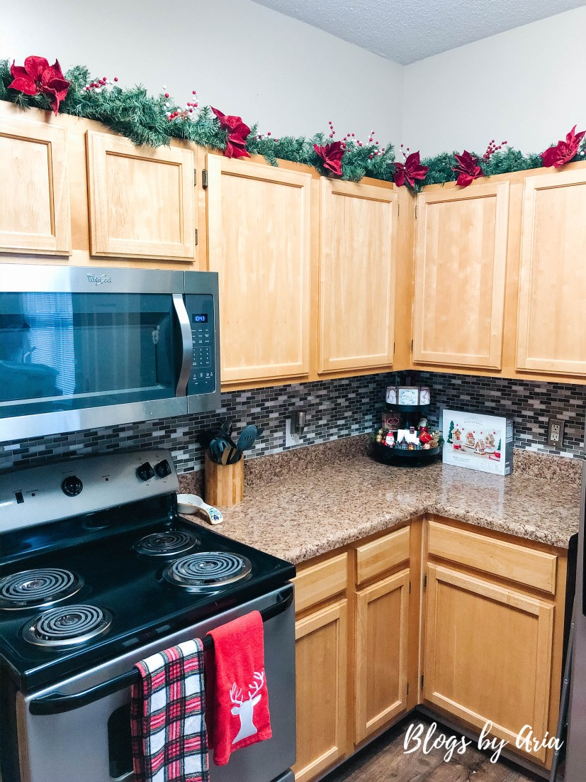 Christmas garland on cabinets