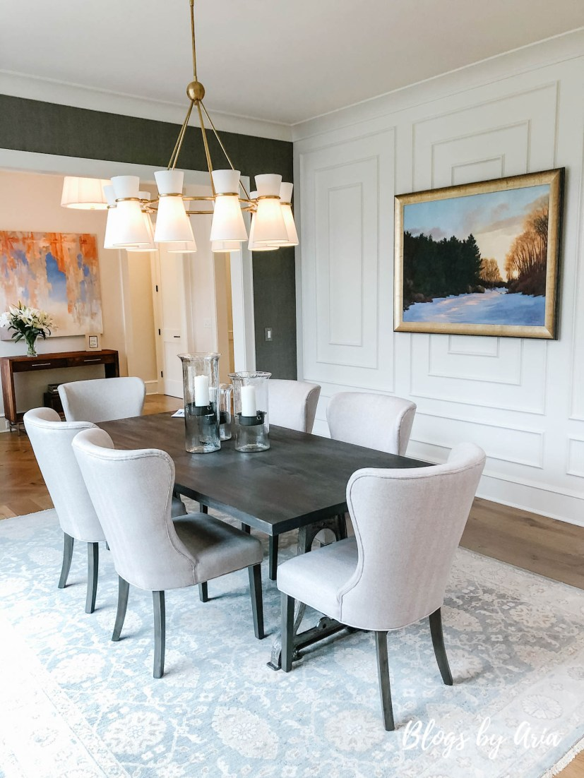 formal dining room featuring extensive custom millwork and trim