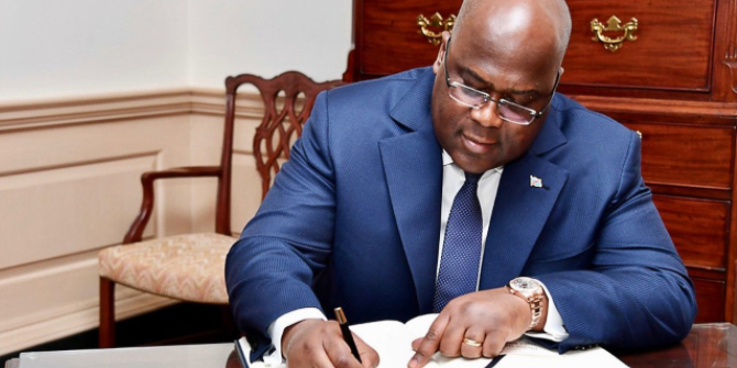 President Felix Tshisekedi signs document.