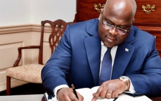 President Felix Tshisekedi signs document.