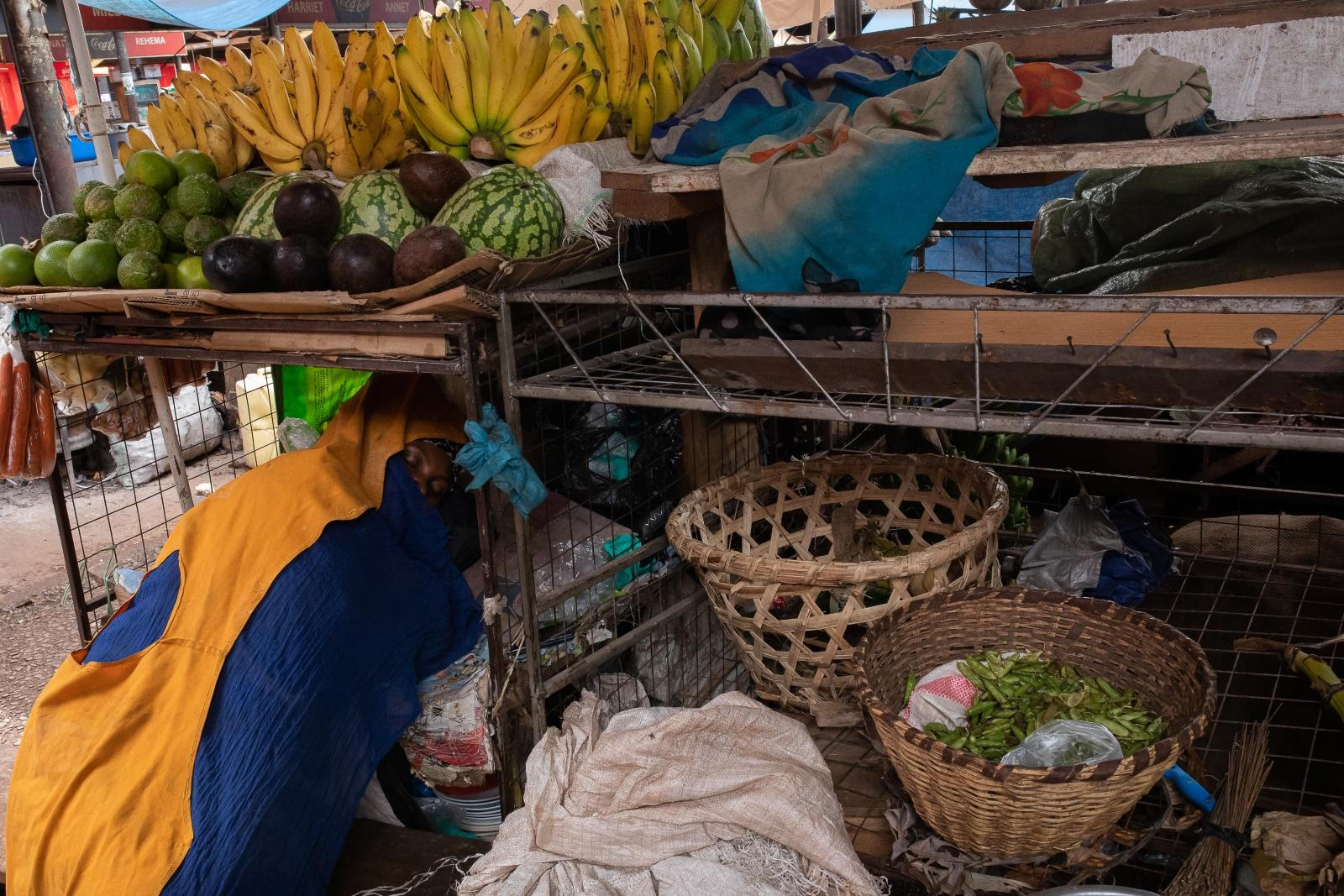 A woman asleep in her fruit stall