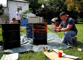 Mixing paint. Photo credit: Brian Schneider, www.ebrianschneider.com