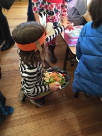 A TNCS student passes around her special fruit tray.