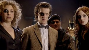 River Song (Alex Kingston), The Doctor (Matt Smith) and Amy Pond (Karen Gillan) - Doctor Who - The Wedding of River Song (c) BBC