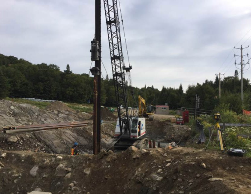 The crane drives the piles to provide the necessary support for the foundation of the lower terminal.