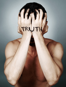 "man covering face with hands with ""truth"" print"