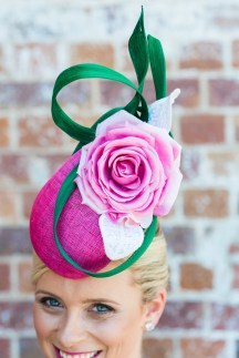 Custom headpiece by Pink Lane Hats.