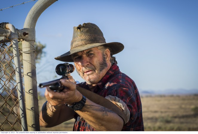 WolfCreek2_John Jarratt as Mick Taylor with gun 8