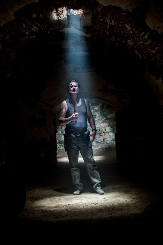 WolfCreek2_John Jarratt as Mick Taylor in tunnels