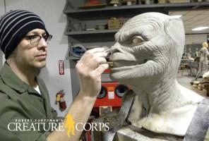 David Greathouse sculpts the female werewolves head.