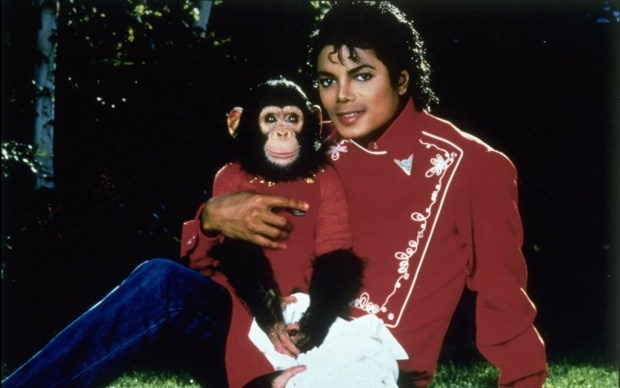 The pop star with his pet 'Bubbles'.