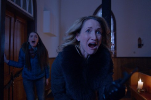 """(L-R): Amy Forsyth as Caprice Bauer and Michelle Nolden as Dianne Bauer in the horror film """"A CHRISTMAS HORROR STORY"""" an RLJ Entertainment release. Photo credit: RLJ Entertainment."""