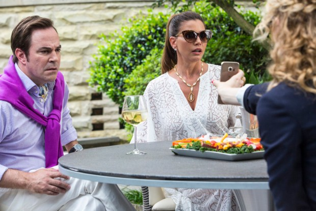 """SCREAM QUEENS: Pictured L-R: Roger Bart as Dr. Herfmann, Charisma Carpenter as Mrs. Herfmann and Skyler Samuels as Grace in the """"Chainsaw"""" episode of SCREAM QUEENS airing Tuesday, Sept. 29 (9:00-10:00 PM ET/PT) on FOX. ©2015 Fox Broadcasting Co. Cr: Skip Bolen/FOX."""