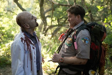 David Koechner who plays Scout Leader Rogers comes face-to-face with a zombie in SCOUTS GUIDE TO THE ZOMBIE APOCALYPSE from Paramount Pictures.