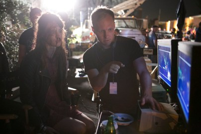 """Director Robbie Pickering watches playback with a bloodied Mackenzie Davis on the set of Columbia Pictures' """"Freaks of Nature."""""""