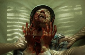 BASEMENT 2- Chester writhes in agony after his attack on Sophie - image from film