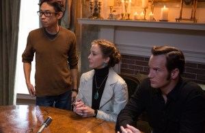 (l-r) Director James Wan along wtih Vera Farmiga as Lorraine Warren and Patrick Wilson as Ed Warren on the set of THE CONJURING 2. ©Warner Bros. Entertainment / Ratpack-Dune Entertainment LLC. CR: Matt Kennedy.