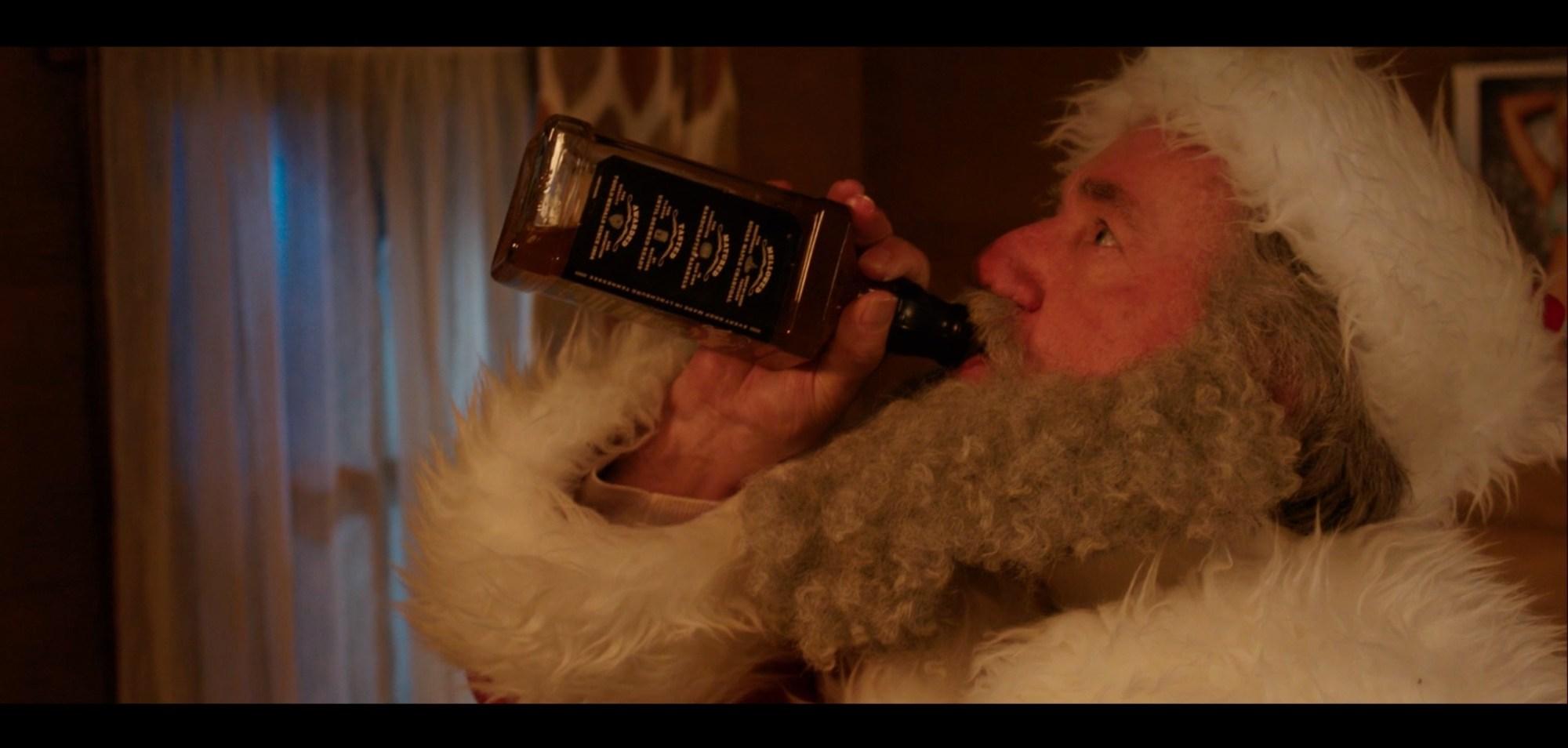 Still frame from The Naughty List short film of Santa swigging whiskey.