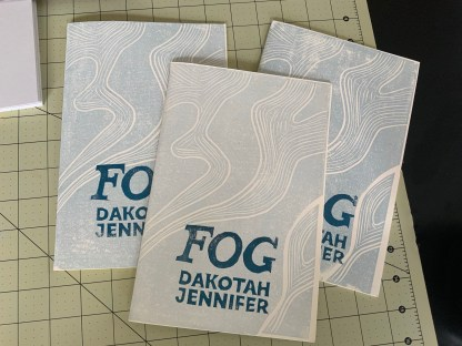 Three copies of Fog, showing variations in linocut printing and ink colors.