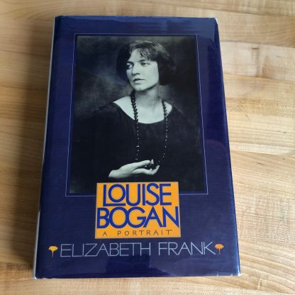 A copy of Louise Bogan: A portrait in hardcover, lying on a maple tabletop. The jacket is purple with purple title in a light orange box below a black-and-white portrait photo of Bogan.
