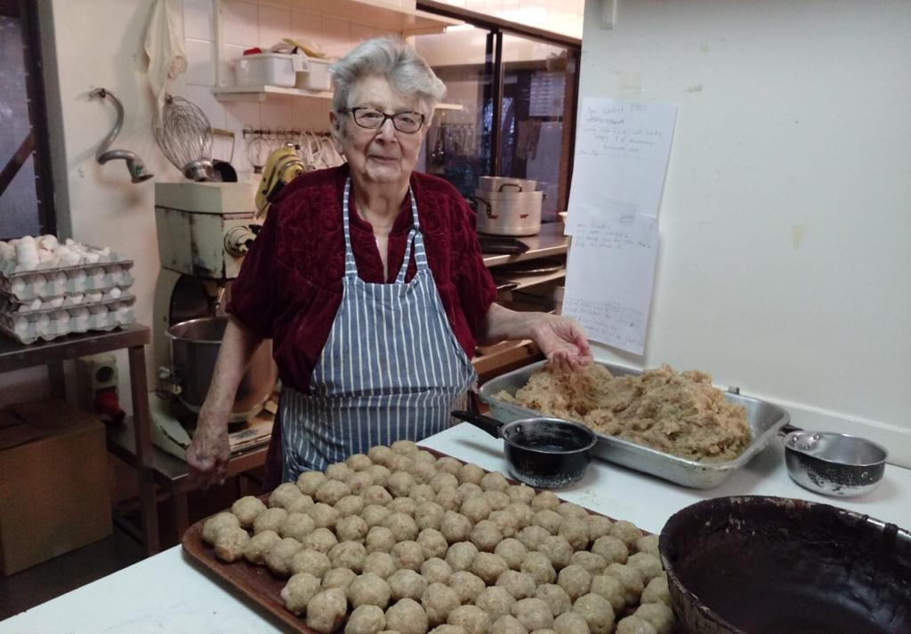 Mrs. Grunfeld at work making her legendary gelfilte fish balls, which were a staple for so many of us on a Jewish festival or at a kiddush for over 5 decades