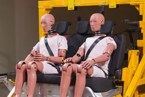 Two crash test dummies in chairs