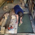 Me leveling the slab that will support the main section of the kiln