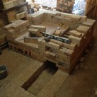 Walls beginning to build up to above the flue and to the burner ports.