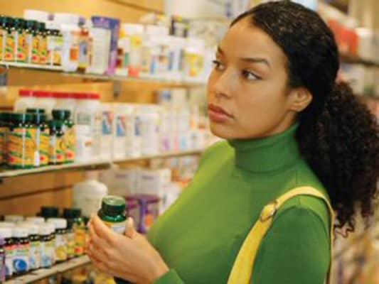 Woman-picking-medicine