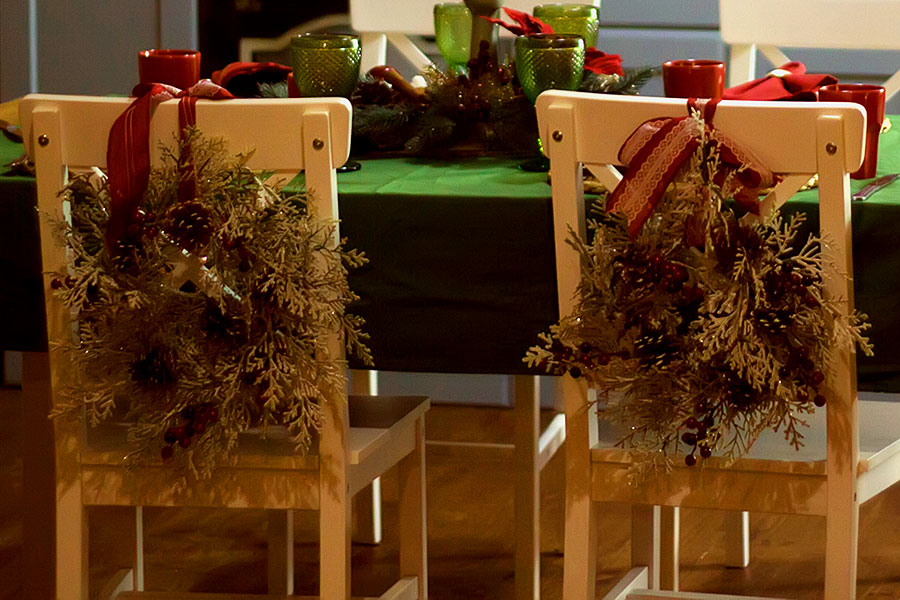 christmas table decorated chair backs with rustic wreath pine garlands