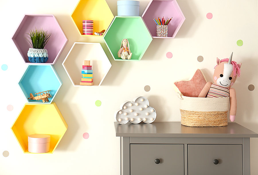 bright colorful hexagonal wall shelves in kids bedroom