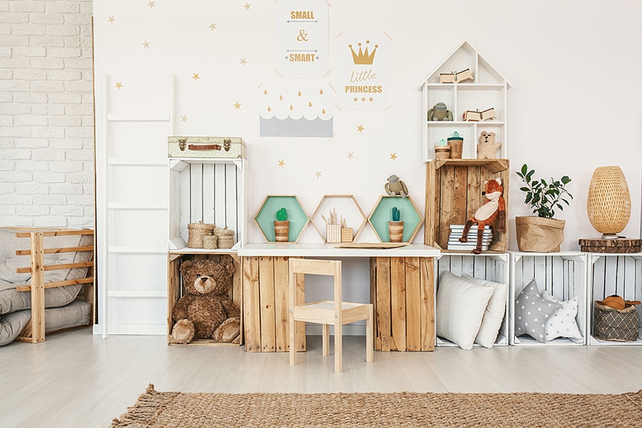white kid room interior with wooden creates for kids toy storage