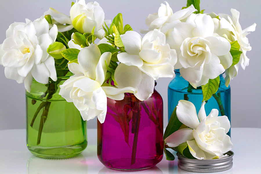 colorful mason jars with flowers for Easter decorations