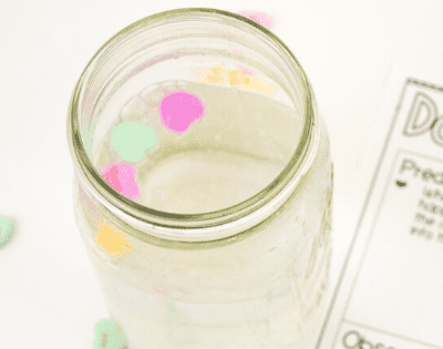 Candy Hearts floating in mason jar during the Dancing Conversation Hearts Science Experiment